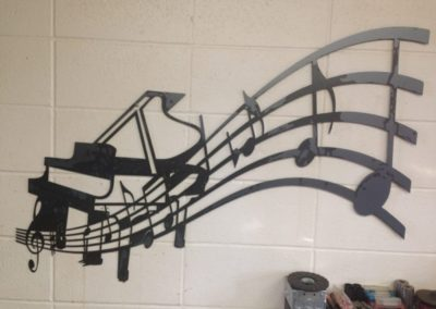 Image of Piano with Music Notes